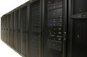 Several racks of 1u and 2u servers in black cabinets.  Image is isolated on white background.  Includes clipping path.